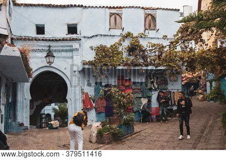 Chefchaouen, Morocco - October 26, 2018: Tourist Exploring The Picturesque Streets Of The Blue City