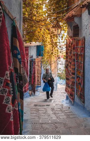 Chefchaouen, Morocco - October 26, 2018: European Tourist Walking In The Picturesque Streets Of The