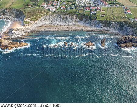 Dramatic View Of Playa De La Arnia, Rocky Coastline In Santander , Cantabria, Spain