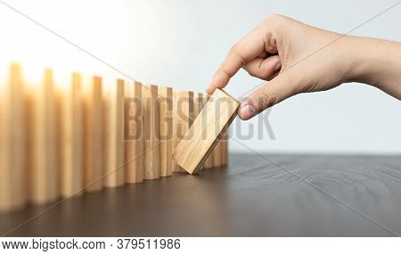 Strategies and risks of wooden games,   Close-up of business people gambling with investment risk, B