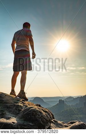 Man On Top Of Mountain. Conceptual Design. Misty Valley. Man Hike.person Silhouette Stand.foggy Moun