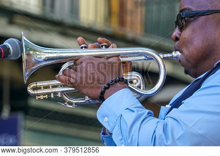 New Orleans - 04/15/2018 : Jazz Man Playing Trumpet During Exhibition In Bourbon Street, For The Jaz