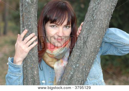 Girl Between Trees