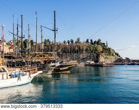 Antalya, Turkey - February 22, 2019: Old Fashioned Tourist Yacht At The Pier In The Harbor In Old To