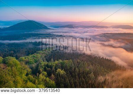 Lazy Misty Morning. Foggy Forest During Autumn Sunrise, Saxon Switzerland, Germany.