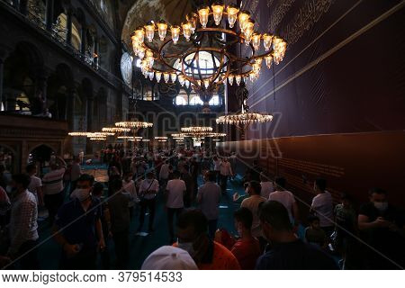 Istanbul, Turkey - August 01, 2020: People Visit And Pray Hagia Sophia After Its Conversion To Mosqu