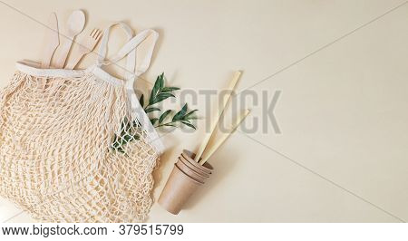Grocery Eco Mesh Bag With Biodegradable Cutlery, Paper Cups, Bamboo Straws And Green Leaves. Plastic