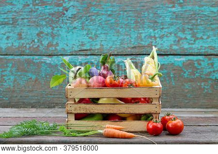 Crate With Ripe Farm Fruits And Vegetables On Rustic Peeling Paint Wooden Background. Space For Your