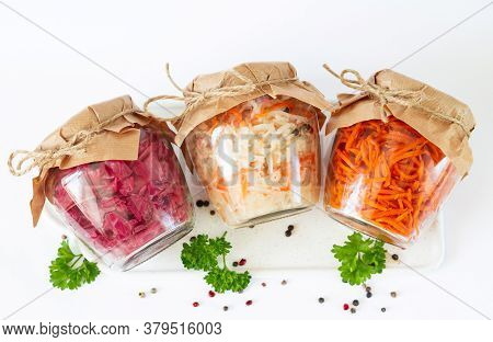 Homemade Marinated Canned Vegetables. Three Glass Jars Of Delicious Fermented Food.
