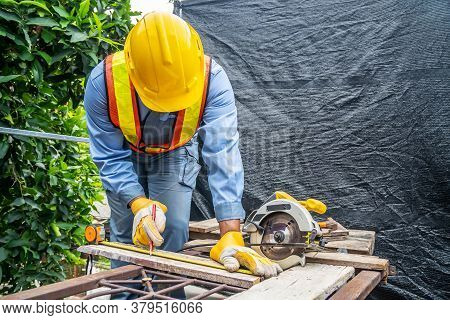 Construction Worker Are Using Tape Measurements To Measure Planks And Pencil Are Used To Write, Clos