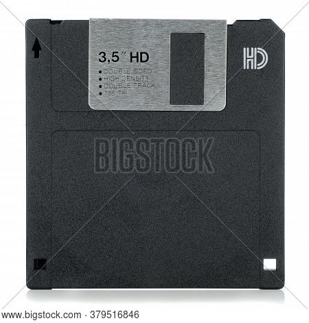A 3.5 Inch Computer Floppy Disc Viewed From The Front On A White Background With Copy Space For Your
