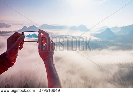 Hand Holding Smart Phone Take Photo. Traveller Make Photo On Smartphone, Using Phone In Hand, Travel