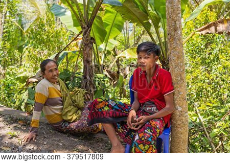 Bali, Indonesia - September 17, 2019: Mother and son in rural Bali, Bali Island, Indonesia