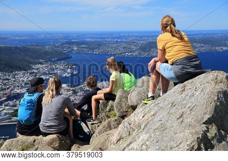 Bergen, Norway - July 23, 2020: People Enjoy The View From Ulriken Mountain Trail Overlooking City O