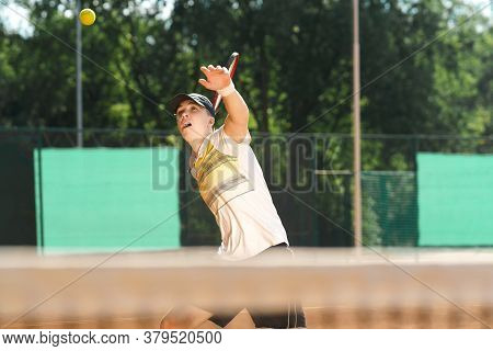 Young Tennis Player Hitting The Ball. Sport Lifestyle