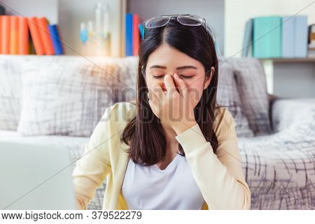 Overworked Tired Woking Woman Hold Spectacles And Touching Her Nose Bridge. Tired Of Computer Asian
