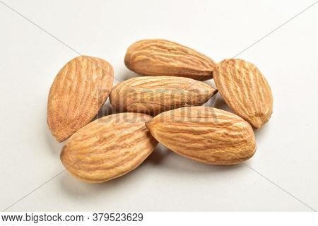 Closeup Of Almonds, Isolated On The White Background.