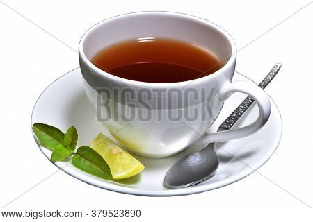 Cup Of Tea With Lemon Slice And Mint With Spoon Isolated With White Background