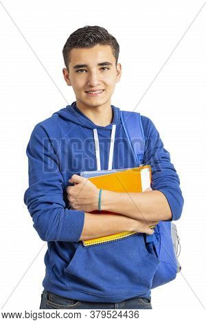 Young Latin Man With His Books In Hand On White Background. Man Looking At The Camera