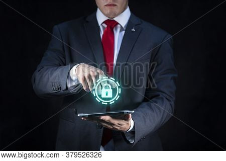 Elegant Businessman And Technology Virtual Projection Of Padlock And Security Icon On Dark Backgroun
