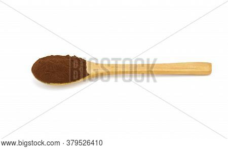 Wooden Spoon With Coffee Powder On White Background. With Shadow