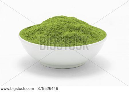 Porcelain White Bowl Wit Matcha Green Tea Texture On White Background