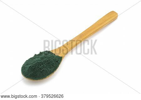Spirulina Seaweed Dust Food Supplement In Wooden Spoon On White Background