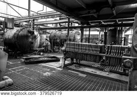 Abandoned Old Destroyed Factory In Industrial Zone. Black And White.