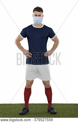 Young Soccer Player On Grass With Blue Shirt And Mask In Face On White Background
