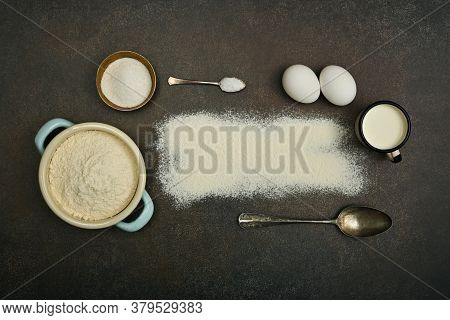 Close Up Flat Lay Of Baking Ingredients On Dark Grunge Stone Table Surface With Copy Space, Milk, Fl