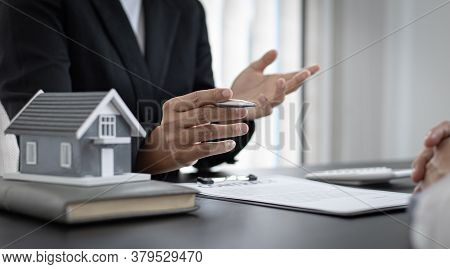Real estate broker agents advise clients to make a decision to buy a house with insurance. Negotiati