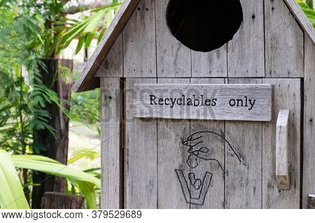 Wood Garbage Bin With Sign And Logo That This Bin Will Use For Recyclables Trash Only. With Nature A