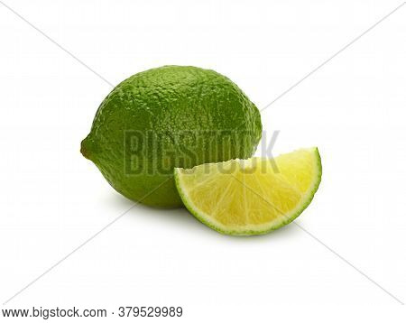 Close Up One Whole Fresh Green Lime Fruit And Cut Slice Wedge, Isolated On White Background, Low Ang
