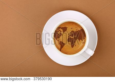 Close Up White Cup On Saucer, Full Of Espresso Coffee With World Map On Froth Crema, Over Background