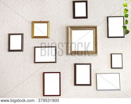 Mockup Image. Different Size Picture Framed Hanging On The Gray Wall. Blank Of Wooden Frames Picture