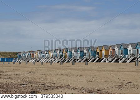 Coast And Sandy Beach At The North Sea In Vlissingen In The Netherlands. Colorful Houses On The Beac