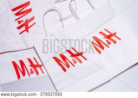 Tyumen, Russia-august 01, 2020: H And M Shopping Bag. H And M Logo On A White Package Top View