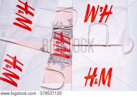 Tyumen, Russia-august 01, 2020: H And M Logo On A White Package Top View. H And M Hennes Mauritz Ab