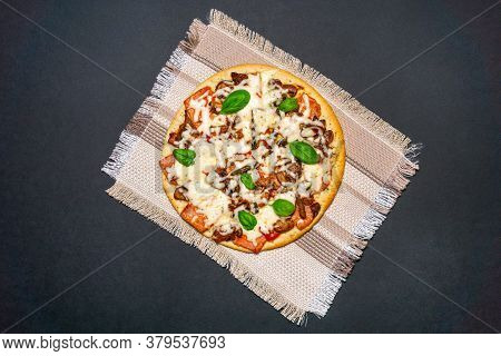 Pizza With Mozzarella Cheese, Ham, And Fresh Basil. Italian Pizza.on Black Background. With Copy Spa