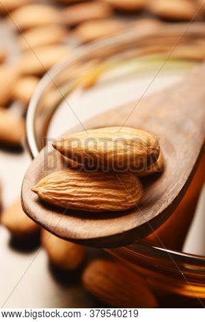Close Up Of Almonds In Wooden Spoon, Almond Macro Image