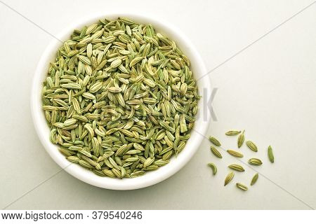 Fennel Seeds In White Bowl Isolated On White Background, Top View
