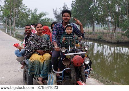 KUMROKHALI, INDIA - FEBRUARY 24, 2020: Indian tricycle motor rickshaw carrying passenger, Kumrokhali, West Bengal