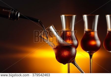 Pouring Alcoholic Drink In Glass With Natural Ice. Steamed Glasses With Strong Alcoholic Drink. Copy