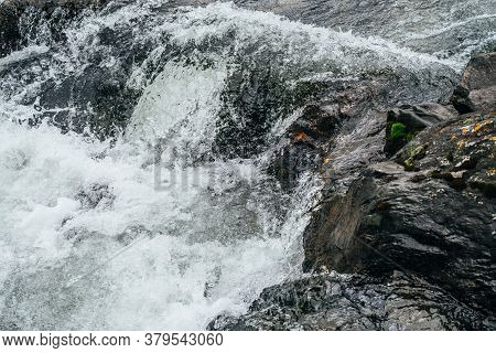 Full Frame Nature Background Of Water Riffle Of Mountain River. Powerful Water Stream Of Mountain Cr