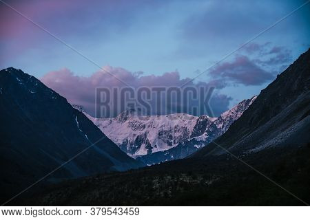 Amazing Landscape Of Sunset With Pink Snowy Mountains And Lilac Clouds. Atmospheric Highland Scenery