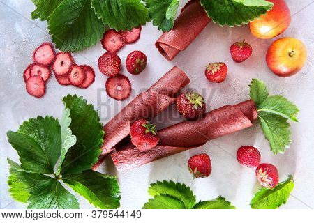 Natural Strawberry Pastille Is Rolled Into A Cone And Into Tubes. Dainty And Berries On A Light Back