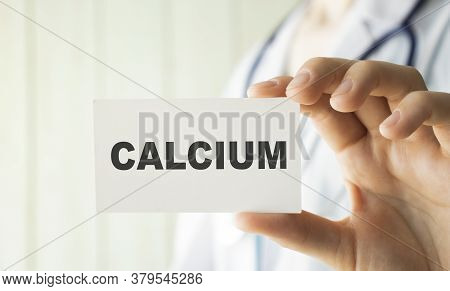 Doctor Holding A Card With Text Calcium, Medical Concept.