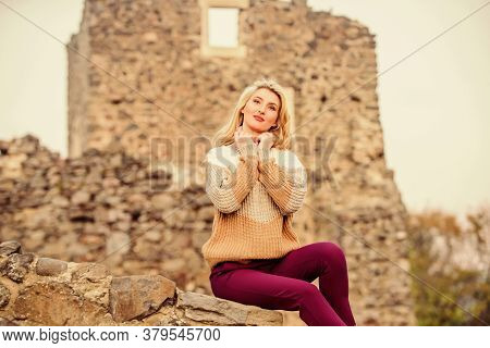 Lucky To Start The Day Here. Girl In Sweater. Fashionable Girl Tourist. Autumn Vacation To Ancient C