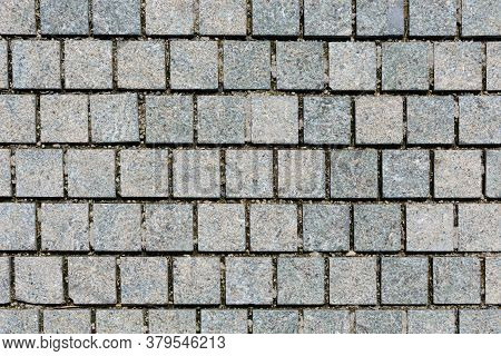 Brickwork From Gray Bricks In Park. Background