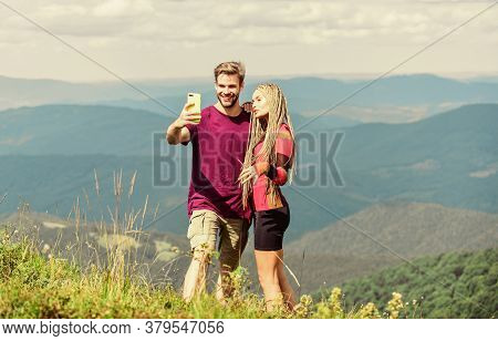 Capturing Beauty. Man And Woman Posing Mobile Photo. Summer Vacation Concept. Young Adventurers. Tra